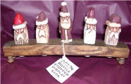Carved Santas in a Wine Barrel Stave display rack!