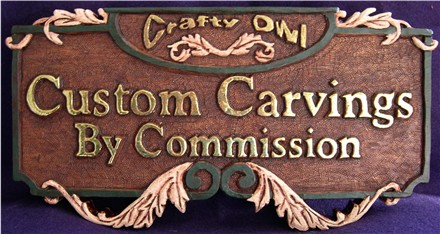 Hand carved mahogany wood sign
