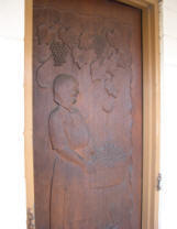 Carved door leading to tank room.