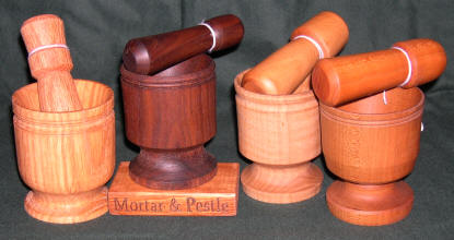 Small wooden mortar and pestle sets.